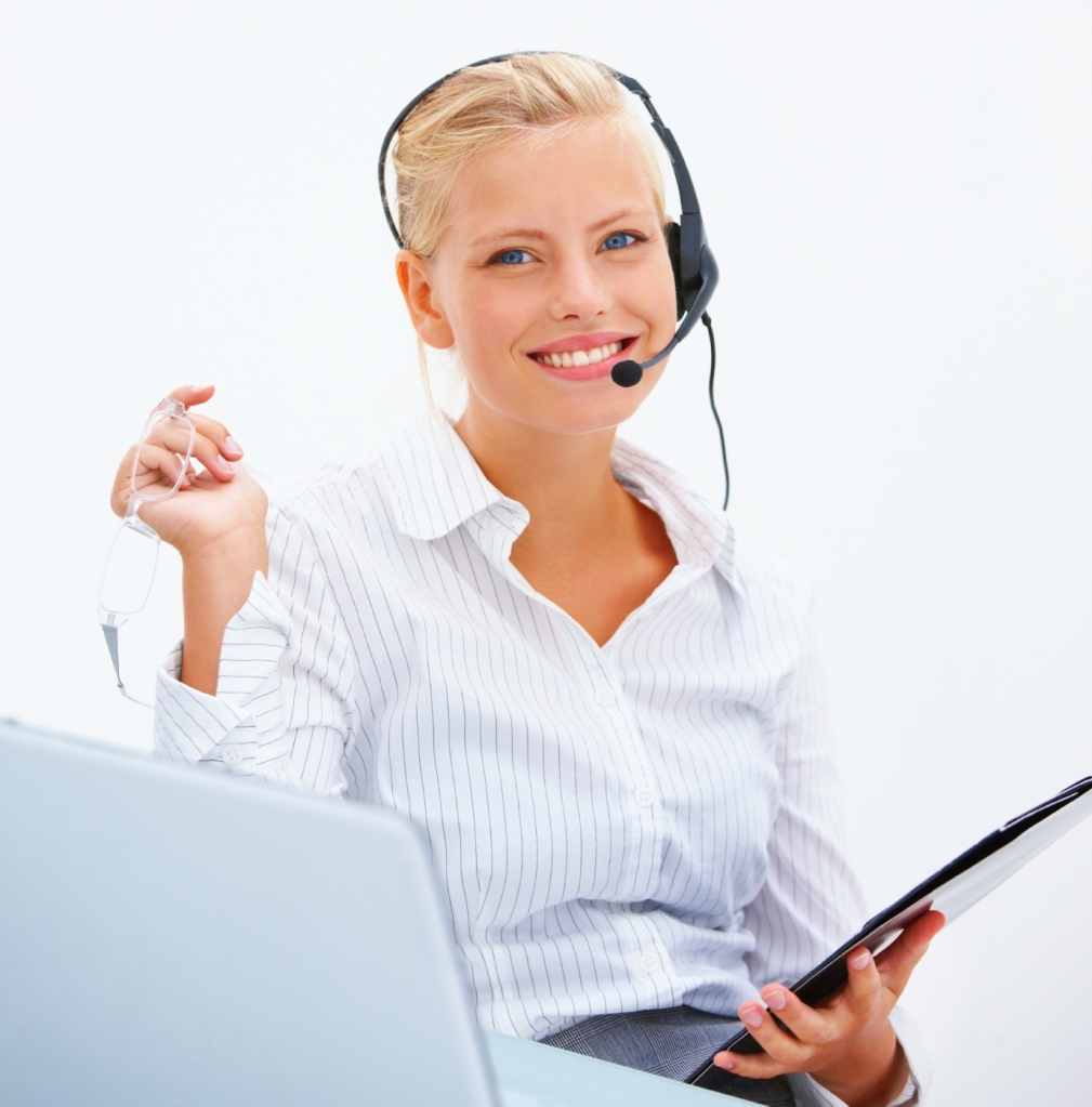 Closeup of a cheerful business woman wearing headset isolated on white background