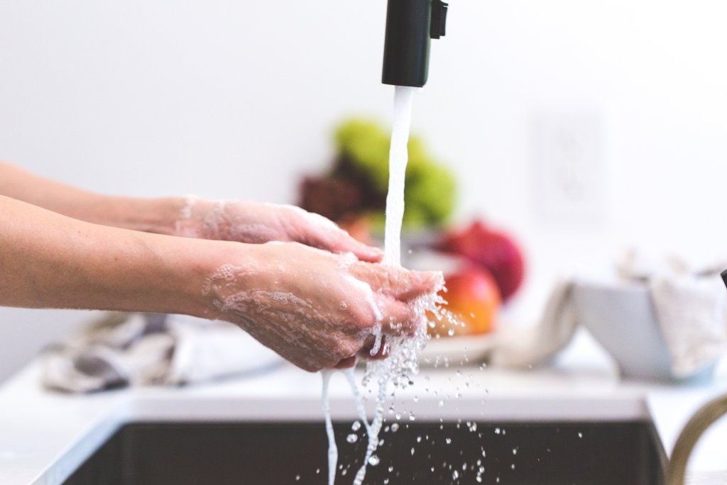 Lady washing her hands to help prevent Covid-19