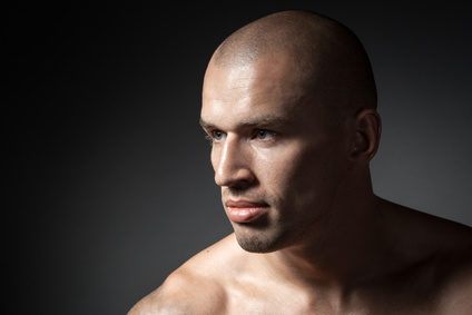 portrait of strong man isolated on dark background