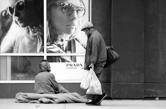 Homeless people outside a luxury store in Los Angeles.